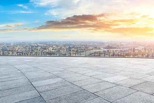 693903950 istock photo Panoramic skyline and buildings with empty city square floor 1048562152