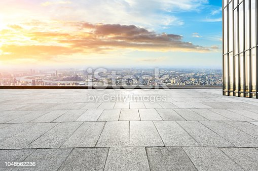 693903950istockphoto Panoramic skyline and buildings with empty city square floor 1048562236