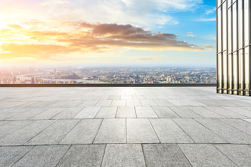 693903950 istock photo Panoramic skyline and buildings with empty city square floor 1048562236