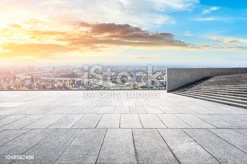 693903950istockphoto Panoramic skyline and buildings with empty city square floor 1048562456
