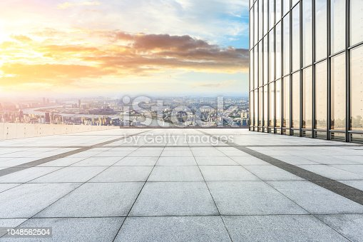 693903950istockphoto Panoramic skyline and buildings with empty city square floor 1048562504