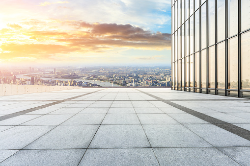 693903950 istock photo Panoramic skyline and buildings with empty city square floor 1048562504