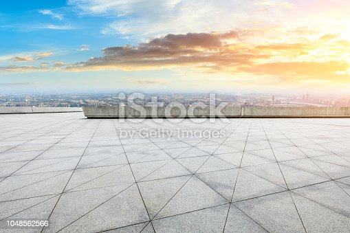 693903950istockphoto Panoramic skyline and buildings with empty city square floor 1048562566