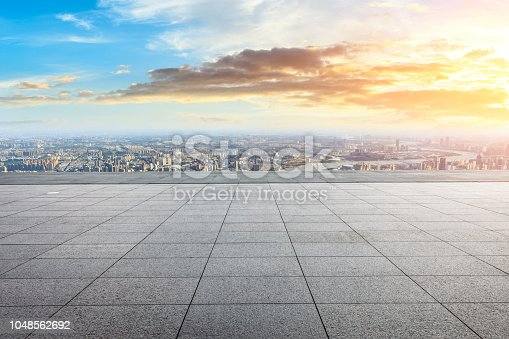 693903950istockphoto Panoramic skyline and buildings with empty city square floor 1048562692