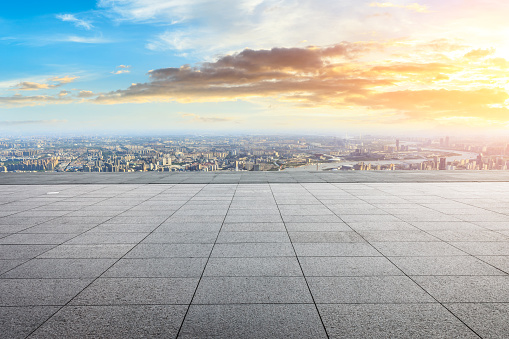 693903950 istock photo Panoramic skyline and buildings with empty city square floor 1048562692