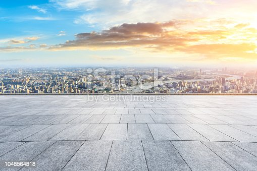 693903950istockphoto Panoramic skyline and buildings with empty city square floor 1048564818