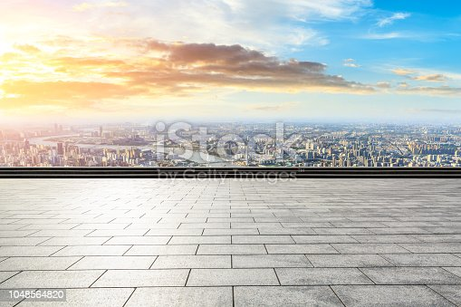 693903950istockphoto Panoramic skyline and buildings with empty city square floor 1048564820