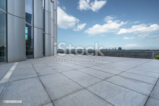 693903950istockphoto Panoramic skyline and buildings with empty city square floor 1068988056
