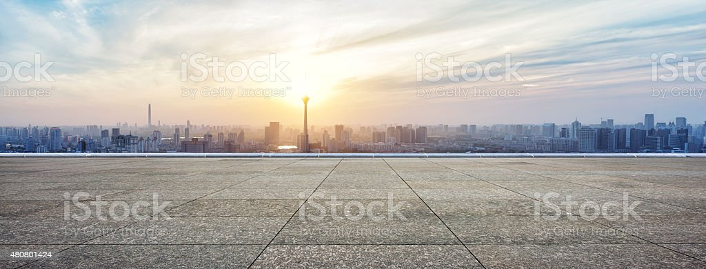 Panoramic skyline and buildings with empty concrete square floor stock photo
