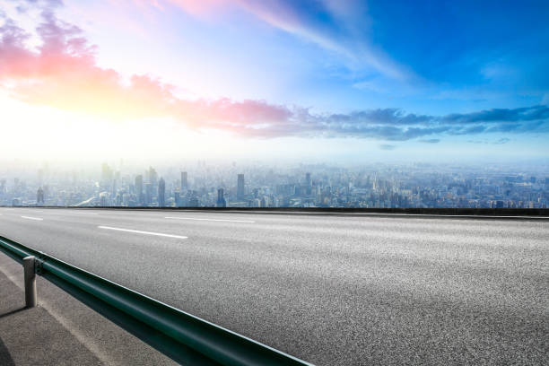 Panoramic skyline and buildings with empty road Panoramic Shanghai skyline and buildings with empty road horizon over land stock pictures, royalty-free photos & images