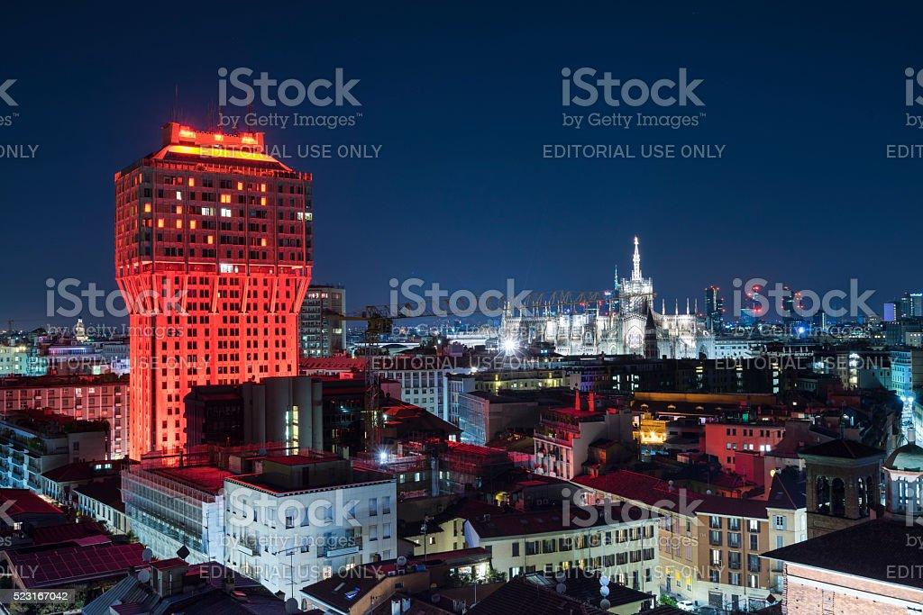 Panoramic Skyline of Milan with red illuminated Velasca Tower stock photo