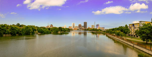 panoramic skyline of rochester new york. rochester is a city on lake ontario, in new york state. old industrial buildings cluster near the genesee river's high falls - rochester ny skyline stock photos and pictures
