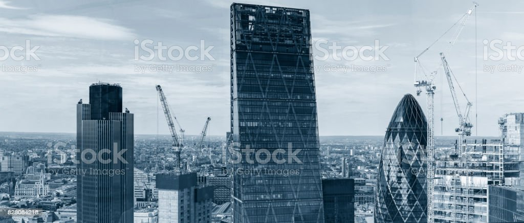 Panoramic skyline with the landmark corporate buildings of the City of London at day stock photo
