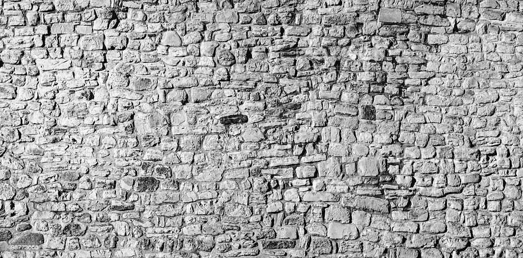 Panoramic stone wall background in black and white stock photo