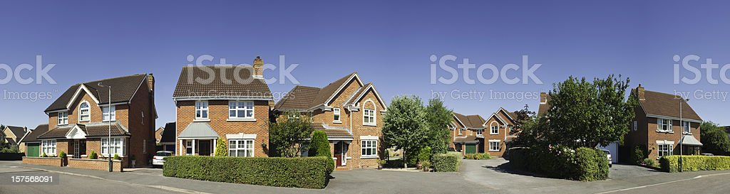 Panoramic suburban street scene in summer. stock photo