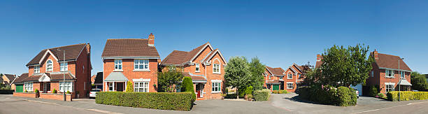 panoramic suburban street scene in summer. - terraced houses stock photos and pictures