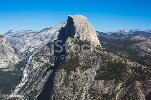 Panoramic summer view of Yosemite valley with Half Dome mountain, Tenaya Canyon, Liberty Cap, Vernal Fall and Nevada Fall, seen from Glacier point overlook, Yosemite National Park, California