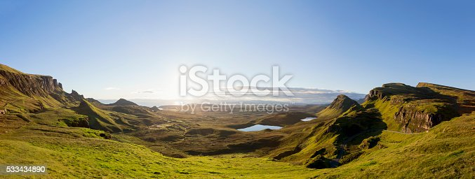 Sunrise at the Quiraing on Isle of Skye, Scotland. Panoramic composite of 3 images