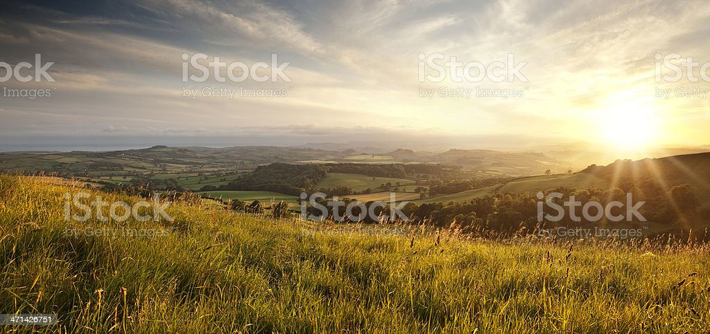 Panoramic sunset over English countryside in Dorset stock photo