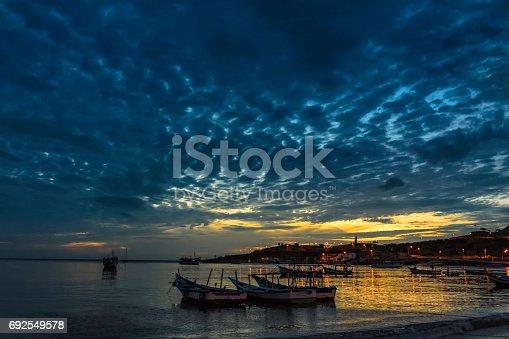 istock Panoramic Sunset view of fishermen´s  boats at Juan Griego bay, Margarita island, Venezuela 692549578