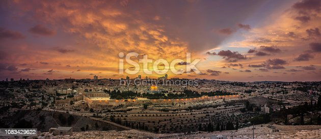 Panoramic sunset view of Jerusalem Old City, City of David and Temple Mount from the Mount of Olives