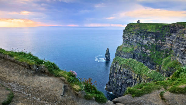 panoramic sunset view of the cliffs of moher with sea stack, ireland - cliffs of moher stock pictures, royalty-free photos & images