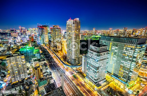 1015890826 istock photo panoramic urban city skyline aerial view under twilight sky and neon night with highway junction and shiodome acty in hamamatsucho, tokyo, Japan 946521692