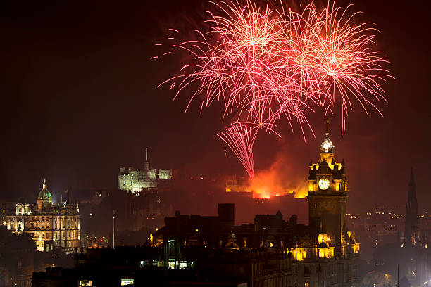 Panoramic vew on Edinburgh castle with fireworks Edinburgh Cityscape with fireworks over The Castle and Balmoral Clock Tower princes street edinburgh stock pictures, royalty-free photos & images