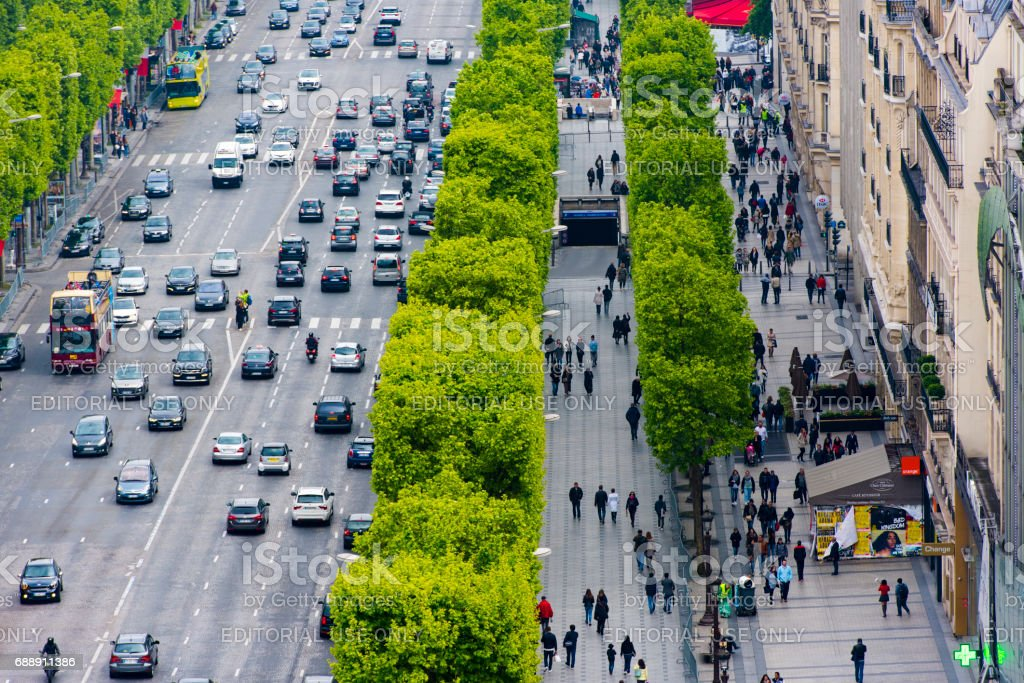 Panoramic view at  Avenue des Champs-Élysées: buildings, streets, cars and tourists in Paris in France stock photo