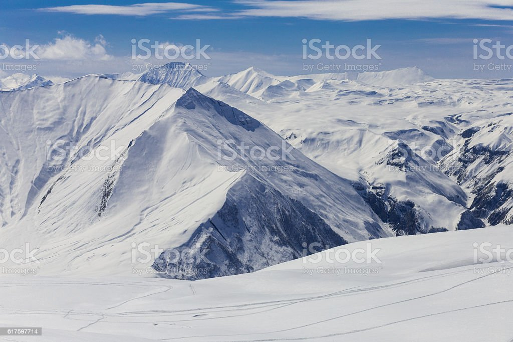 Panoramic view at snowy mountains stock photo