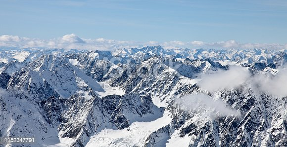 istock Panoramic view from a high point on the snow-covered mountain range. Mountain Altai. 1152347791
