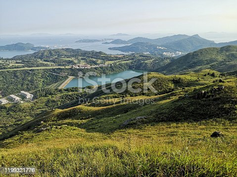 Idyllic panorama from Lo Fu Tau, also known as Tiger's Head, located in the Lantau North Country Park. The hike goes from Tung Chung to Discovery Bay with another path connected to the Olympic Trail which goes from Tung Chung to Mui Wo.