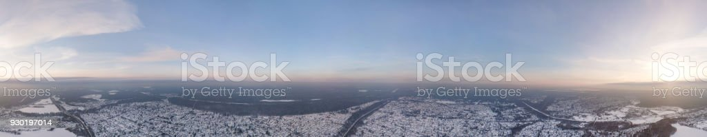 panoramic view from the air to the snow-covered village stock photo