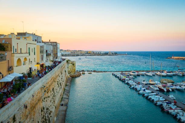 OTRANTO, ITALY - AUGUST 23, 2017 - panoramic view from the old town at sunset during turistic season stock photo