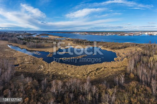 Panoramic view from the side of Bolderaja towards the Love island. The Baltic sea can be seen in distance. Photo taken from a drone
