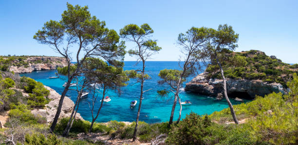 """Panoramic view of a beautiful cove in Majorca called """"Calo des Moro"""" stock photo"""