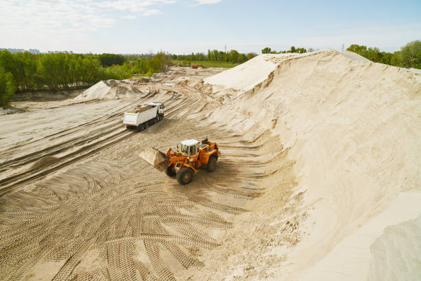 Panoramic view of a bulldozer in a sand quarry on a clear spring day. stock photo
