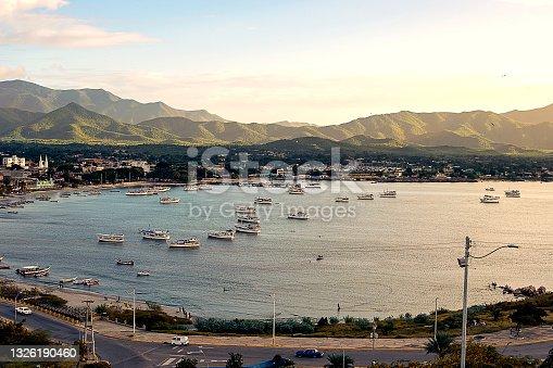 istock panoramic view of a coast, beach, sky, mountain, hotel, city, boats 1326190460