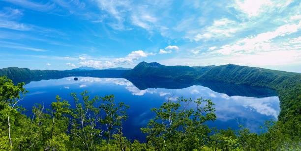 panoramic view of a lake reflecting sky. Lake Mashu,Akan National Park,Japan. stock photo