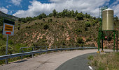 Panoramic view of a lonely road with a deposit of salt for the winter - Image