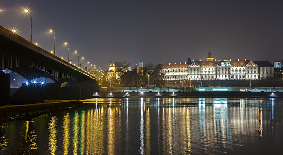 Panoramic view of a waterfront at night.