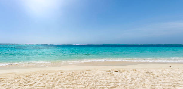 Panoramic view of a white sand beach with turquoise waters in the Caribbean sea stock photo