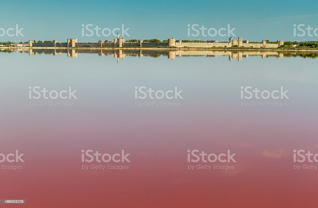 Panoramic view of Aigues-Mortes from salt flats stock photo
