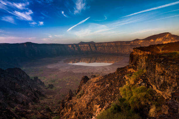 A panoramic view of Al Wahbah Crater at sunrise The crater at the early morning in December saudi arabia stock pictures, royalty-free photos & images