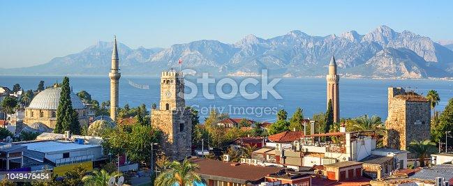Panoramic view of Antalya Kaleici Old Town with the Clock Tower, Yivli Minaret, Tekeli Mehmet Pasa mosque, Mediterranean Sea and the Taurus Mountains in background, Turkey