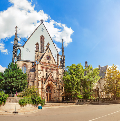Panoramic view of Architecture and Facade of St. Thomas Church (Thomaskirche) in Leipzig, Germany. Travel tourist and religious destination in Europe