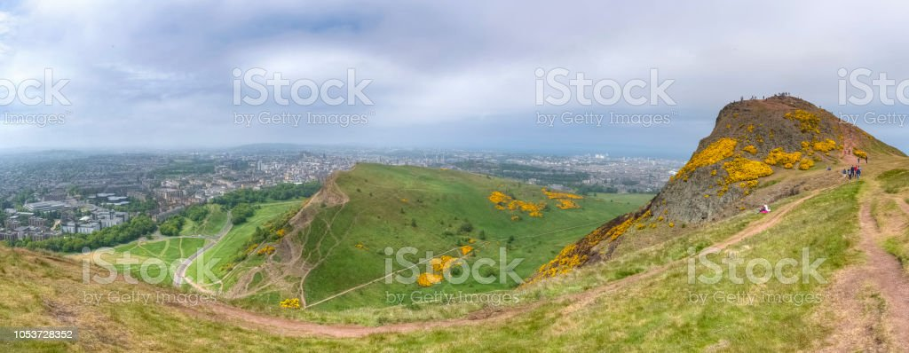 Panoramic view of Arthur's seat and city of Edinburgh on a cloudy day stock photo