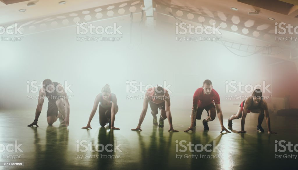 Panoramic view of athletes preparing for sports trace. stock photo