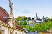 Panoramic view of Baden-Baden city and the angel sculpture. Baden-Baden is a spa town. It is situated in Baden-Wurttemberg in Germany. Its church is called Stiftskirche.