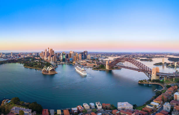 Panoramic View of Beautiful Sunrise at Sydney City Skyline Aerial Panoramic View of Beautiful Sunrise at Sydney City Skyline australia stock pictures, royalty-free photos & images